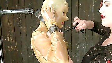 Lesbian in full latex suit tormented