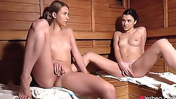 Pair of passionate beauties playing lesbian games in sauna