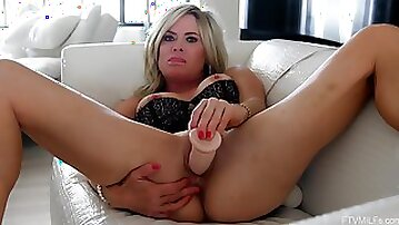 Solo blonde wife treats herself with a big toy cock