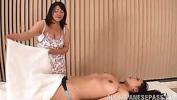 Chybby Japanese woman gets her pussy rubbed by nasty lesbo masseuse