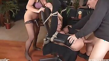Couple plays bondage games with their submissive