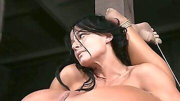 Flexible brunette slut lriver shows off her skills in BDSM porn clip