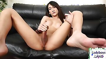 Huge-Titted chinese tgirl jerks her hard-on