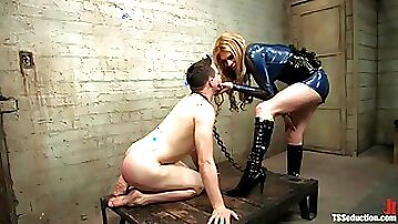 Submissive slave boy worships tranny leather boots and big ass