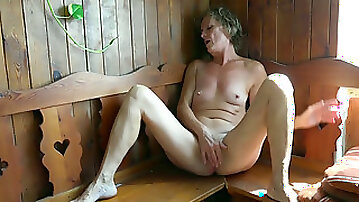 Mature white lady with shaved pussy in solo action