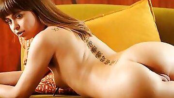 Solo brunette babe Riley Reid smokes a cigarette before pussy masturbation