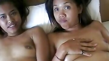 2 very sweet Thai prostitutes jerk and rub a cock until it shoots on their faces.