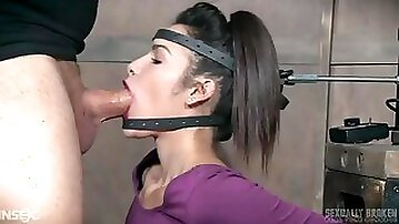 Machine forces her mouth down on a big cock