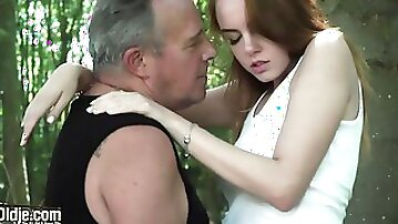 Teen with awesome perky tits Candy Red likes outdoor sex with an old man