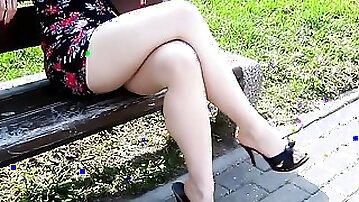 Kinky voyeur films hot legs of that lovely MILF lady at the park