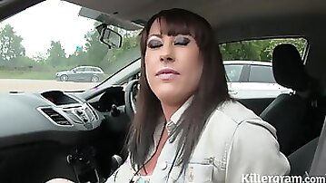 Busty whore covered in cum in a public park