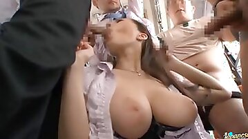 Pretty and Busty Japanese Babe Gets a Blowjob Gangbang in a Bus