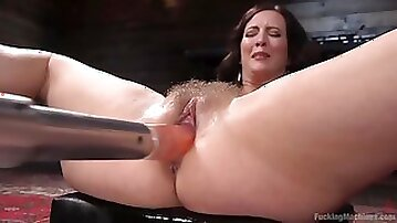 Busty brunette pornstar Cherry Torn gets her hairy pussy drilled by machine