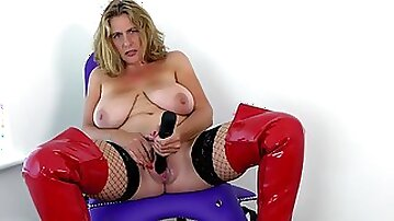 Busty GILF in latex shoes masturbates on a chair