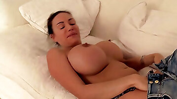 Awesome brunette wanker takes off tight top to play with enormous boobs