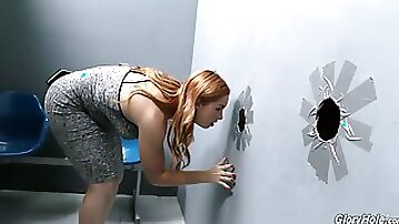 Ginger chick with red haired pussy Edyn Blair is having fun in the glory hole room