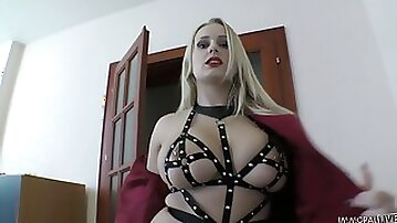 Mega busty blonde in leather straps lingerie Angel Wicky gives a blowjob and footjob