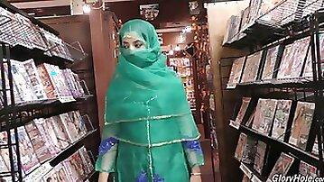 Hot Pakistani chick Nadia Ali sucks big dick in the glory hole room