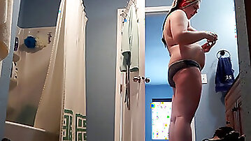 Chubby step-sister Amie caught on spycam, out of shower, insert tampon