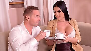 Beautiful fake-boobed brunette Honey Demon rides on a big dick