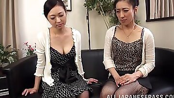 Intimate girl on girl action with adorable Asian couple