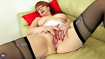 Redhead mature amateur British MILF Red spreads her pussy on the bed