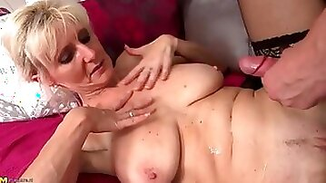 He cums on the hot mature blonde and keeps fucking her
