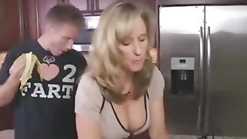 Horny stepson seduces his beautiful stepmom at the kitchen