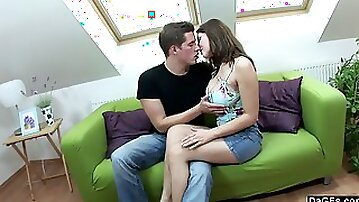 Fucking his busty girlfriend on the couch