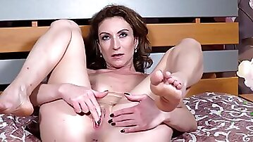 Brunette Dafna May fucks her shaved pussy with a dildo