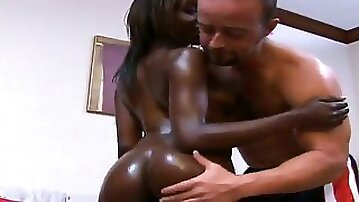 Shinning ebony bitch begs her white lover to go harder