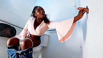 Ebony mom Osa Lovely is sucking the white cock through the glory hole