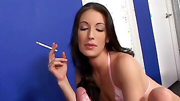 Brandy Lyons smokes while stroking a dick