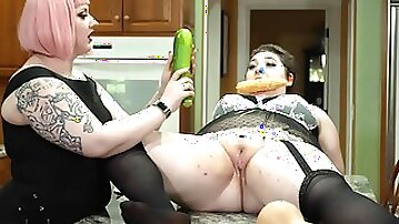 Chubby slut spreads her legs on the table to be poked by her friend