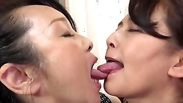 Chubby Japanese masture gets her pussy fingered by a lesbian lady